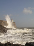 SX10176 Big wave onto lighthouse on harbour wall at Porthcawl point.jpg