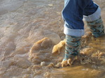 SX11255 Jenni in boots walking through icy puddle.jpg