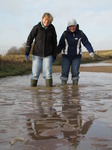 SX11261 Lib and Jenni paddling in icy puddle.jpg