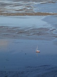 SX11928 Beached sailboat on Swansea Bay mud sands.jpg