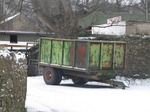 SX12131 Green farm trailer in snow.jpg