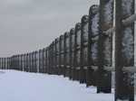 SX12165 Snow on side of pillars of guardrail.jpg