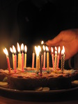 SX12308 Lighting birthday candles on cake.jpg