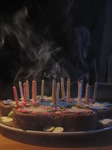 SX12311 Smoking birthday candles on cake.jpg