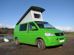 SX12376 Our green VW T5 campervan with popup roof up at Ogmore Castle.jpg