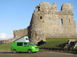 SX12380 Our green VW T5 campervan with popup roof up at Ogmore Castle.jpg
