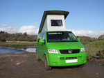 SX12383 Our green VW T5 campervan with popup roof up at Ogmore Castle.jpg