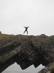 SX13376 Marijn jumping on Devil's bridge at Worms head.jpg
