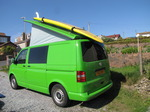 SX14110 Popup up with big yellow surfboard on roofrack.jpg
