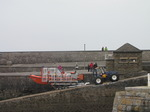 SX14121 RNLI lifeboat being pulled onto harbour slipway by tracktor.jpg