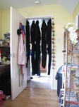 SX14722 Five wetsuits drying in doorway.jpg