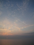 SX14849 Sunrise and airliner over channel.jpg