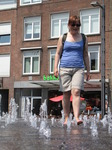 SX14907 Jenni walking through fountain in Arnhem.jpg