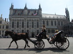 SX15560 Horse and carriage passing town hall in Brugge.jpg