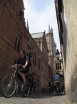 SX15576 Pushbikes and pedestrians in alley in Brugge.jpg