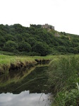 SX15809 Pennard castle ruins reflected in Pennard Pill river.jpg