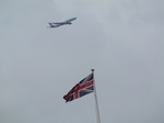 SX15998 Airliner flying past British Flag.jpg