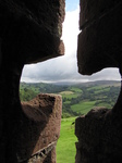 SX16127 View through arrow hole of Carreg Cennen Castle.jpg