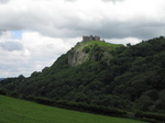 SX16158 Carreg Cennen Castle on top of distant cliffs.jpg