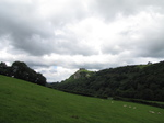 SX16159 Carreg Cennen Castle on top of distant cliffs.jpg