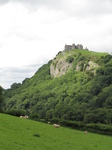 SX16166 Carreg Cennen Castle on top of distant cliffs.jpg