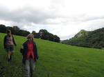 SX16170 Jenni and Margaret setting off again with Carreg Cennen Castle on top of distant cliffs.jpg