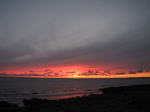 SX16497 Red and orange sky at sunset at Ogmore by Sea.jpg