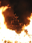 SX16802 Guy on top of bonfire.jpg