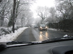 SX17028 Cars driving through snow on country lane.jpg