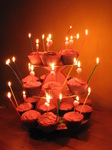 SX17137 Jen's cupcake birthday cakes with candles lit.jpg