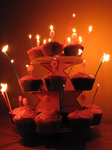 SX17138 Jen's cupcake birthday cakes with candles lit.jpg