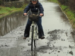 SX17151 Jenni cycling through flooded road.jpg