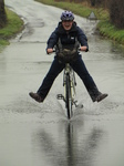 SX17154 Jenni cycling through flooded road.jpg