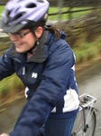 SX17156 Jenni cycling through flooded road.jpg