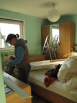 SX17192 Jenni DIYing putting up coving in bedroom.jpg
