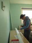 SX17193 Jenni DIYing putting up coving in bedroom.jpg