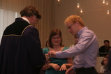 IMG_7189 Richard handing rings to Jenni and Marijn at gemeentehuis.JPG