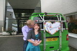 IMG_7312 Marijn and Jenni kissing at Just Married sign on van.JPG