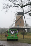 IMG_7318 Marijn and Jenni leaning out van with Just Married sign at windmill.JPG