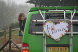 IMG_7324 Jenni leaning out van with Just Married sign.JPG