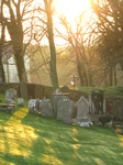 SX17378 Shadows and sunlight on gravestones at St David's Cathedral.jpg
