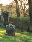 SX17380 Shadows and sunlight on gravestones at St David's Cathedral.jpg