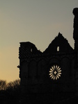 SX17397 Silhouette of wheel window Bishop's Palace.jpg