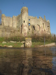 SX17753 Laugharne castle reflected in river Coran.jpg