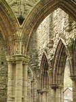 SX17774 Pillars, arches and windows at Tintern Abbey.jpg