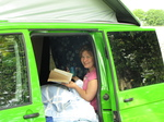 SX18139 Jenni reading and having a cup of tea at Church Farm (Bradford on Avon) campsite.jpg