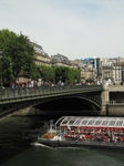 SX18577 Canal boat passing bridge over water and Centre Georges Pompidou, Paris, France.jpg