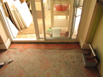 SX18803 Hole by conservatory tiled over.jpg