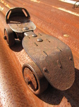 SX18814 Old rusty metal roller skate.jpg