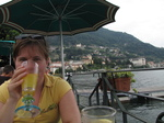 SX19001 Jenni drinking juice on shore of Lake Como.jpg